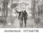 lovers under an umbrella | Shutterstock . vector #157166738