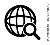 globe and magnifying glass ...