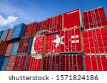The national flag of Turkey on a large number of metal containers for storing goods stacked in rows on top of each other. Conception of storage of goods by importers, exporters
