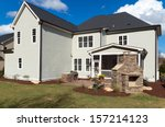 A Large House With Landscaped...