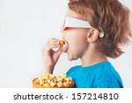 Little Boy In 3d Glasses Eatin...
