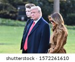 Small photo of WASHINGTON, DC - NOVEMBER 26, 2019: President Donald Trump, First Lady Melania Trump and their son Barron in a close up view as they walk across the South Lawn to Marine One on their way to Florida.