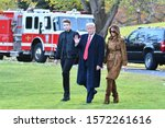 Small photo of WASHINGTON, DC - NOVEMBER 26, 2019: President Donald Trump waves as he walks with First Lady Melania Trump and their son Barron to board Marine One on their way to Florida. White House South Lawn.