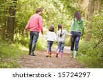 family walking on path holding... | Shutterstock . vector #15724297