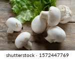 Close Up Of Raw Mushrooms With...