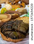 Basket with Oaxaqueño tamales wrapped in banana leaf