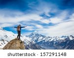 Hiker At The Top Of A Rock Wit...