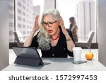 Senior Business Woman With...