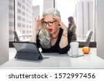 Older Business Woman Panicked...