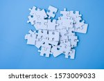 White Jigsaw Puzzle On Blue...