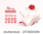 gift box with red ribbon and... | Shutterstock .eps vector #1573034200
