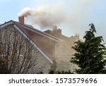 Smoke Rises From The Chimney O...