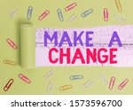 Small photo of Text sign showing Make A Change. Conceptual photo Create a Difference Alteration Have an Effect Metamorphose Paper clip and torn cardboard placed above a wooden classic table backdrop.