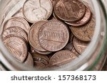 Collection Of Pennies In A Jar