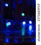 rain drops on window with bokeh ... | Shutterstock . vector #1573683919