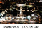 Aerial drone night shot of neoclassic landmark building of Ermoupolis town city hall in Miaouli square, Syros or Siros island, Cyclades, Greece
