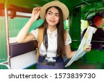 asian woman travel by tuk tuk... | Shutterstock . vector #1573839730