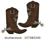 cowboy boots isolated on white... | Shutterstock .eps vector #157385240