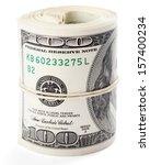 Hundred Dollar Bills Rolled Up...