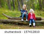 two little sisters sitting on a ... | Shutterstock . vector #157412810