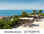 Empty cafe tables high over city and Marmara sea, Istanbul, Turkey - stock photo