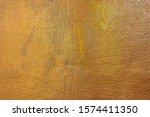 Bumpy texture on gold matte surface