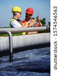 Small photo of Engineers controlling a quality of water ,aerated activated sludge tank at a waste water treatment plant