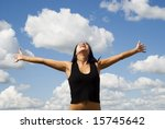 a beautiful woman over sky background - stock photo