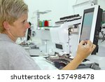 woman working on computerized... | Shutterstock . vector #157498478
