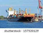 tugboat assisting container... | Shutterstock . vector #157520129
