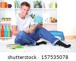 young man relaxing on carpet... | Shutterstock . vector #157535078