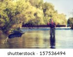 A Person Fly Fishing In A Rive...