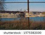 Small photo of Danger keep out sign on the fence that keeps onlookers safe at a Limestone quarry in Delphi Indiana that supplies water to the Wabash and Erie canal