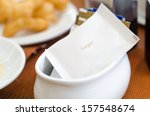sugar packet on table   Shutterstock . vector #157548674