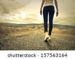 woman walking towards unknown... | Shutterstock . vector #157563164