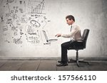 Young Businessman Working In A...