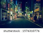 Small photo of TOKYO - APRIL 13, 2017 : Color Billboards in Shinjuku's Kabuki district at night in Japan. Famous Red-light district full of bars, restaurants and night clubs in Tokyo at night