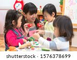 Children studying English at a nursery school