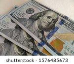 one hundred dollar banknotes on ... | Shutterstock . vector #1576485673