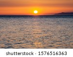 Small photo of Sunset on the Black sea. Ships on the roadstead of Novorossiysk.