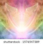 Small photo of Seeking angelic help from your personal Guardian - pair of gleaming shimmering golden angel wings against an ethereal rainbow coloured energy background