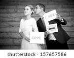 happy groom and bride in a park ... | Shutterstock . vector #157657586