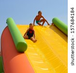 Enthusiastic Kids On Slide In...