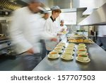 four chefs working in a modern... | Shutterstock . vector #157707503