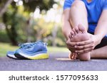 Small photo of Men have a lot of leg pain in the park due to strenuous exercise.