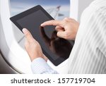 Businessman Holding Digital...