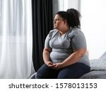 Depressed Overweight Woman On...