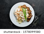 sliced lard on a plate with...