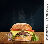 Hamburger With Salad And Onion...