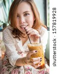 a woman is drinking iced coffee ... | Shutterstock . vector #157819928